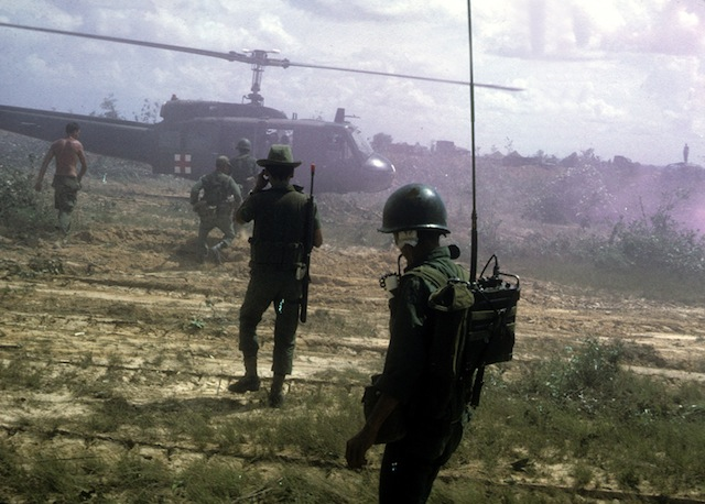 ARVN troops approach helicopter