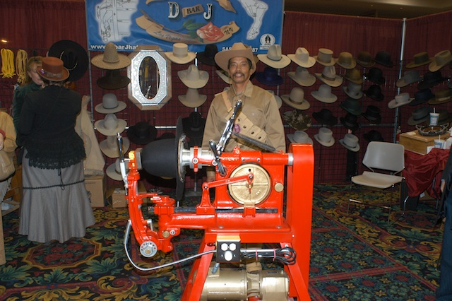 Fernando of D Bar J stands behind the crown sanding machine he and Dave restored from a basket