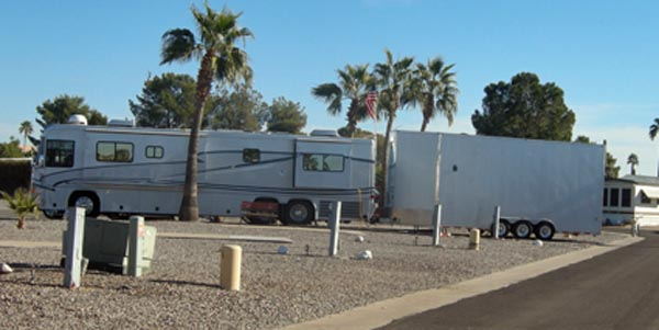 A neighbor at Desert Edge, 45 ft. coach, long enclosed trailer that's taller than the coach.