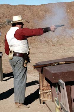 Rowdy Yates firing Cimarron Colt 1860 Army replica in Frontier Cartrdge at Winter Range '02