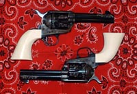 Engraved, matched pair of Colt SAAs, Ivory grips