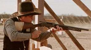 Sundown Tex shoots his Winchester 97