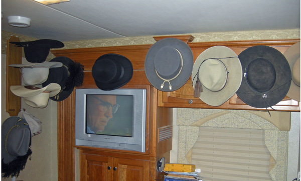 Hats on the wall of the bus