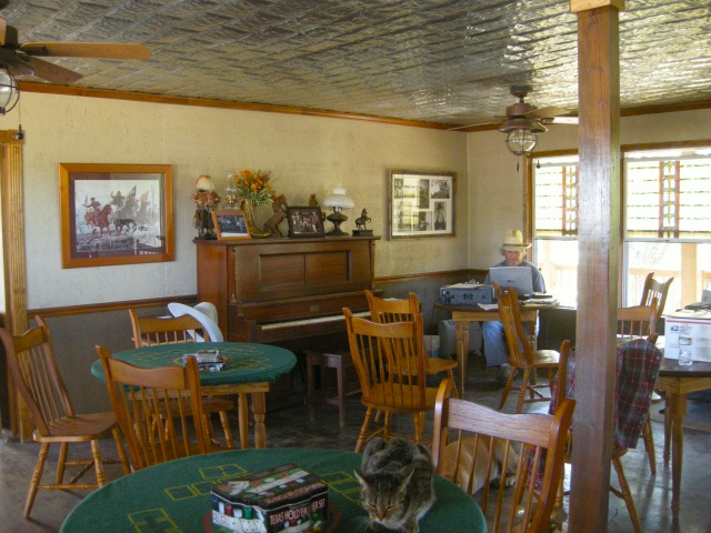 Far corner of the bar, where the gunfighters sit